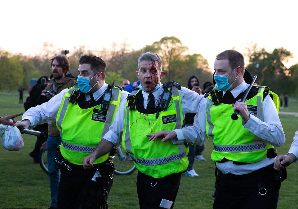 A police officer was left with blood streaming down his face as the protests turned ugly in Hyde Park this evening.